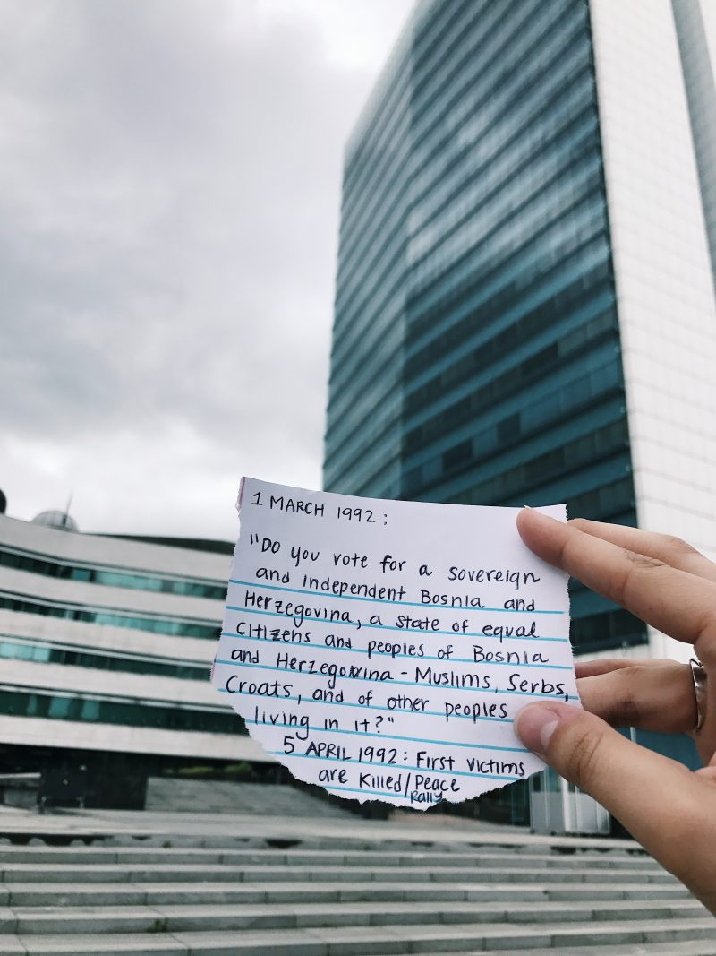 "Scrap of paper in front of government building which reads 1 March 1992: ""do you vote for a sovereign and independent Bosnia and Herzegovina, a state of equal citizens and peoples of Bosnia and Herzegovina - Muslims, Serbs, Croats, and of other people living in it?""  5 April 1992: First victims are killed at a peace rally"
